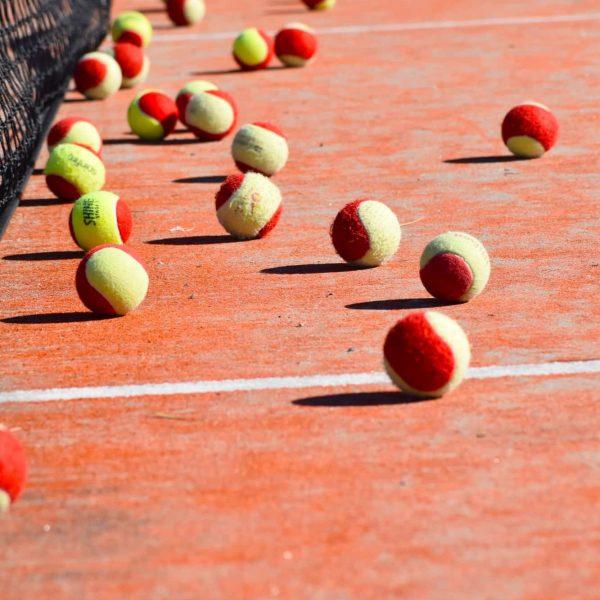 Lots of Tennis Balls Fletcher Tennis Court